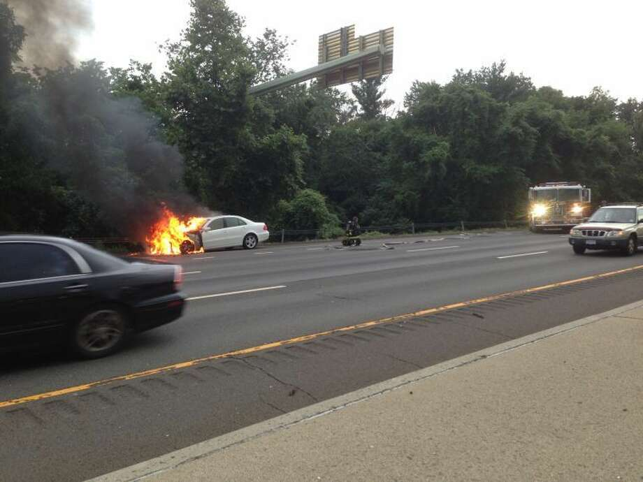 Contributed photoWestport and Fairfield Fire Departments responded to a car fire on I-95 northbound near exit 19 Thursday evening.