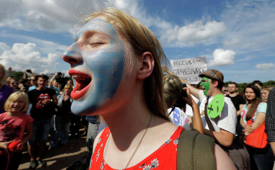 Demonstrators with painted faces chant slogans in support of the Russian punk group Pussy Riot whose members face prison for a stunt against President Vladimir Putin, in St.Petersburg, Russia, Friday, Aug. 17, 2012. Pussy Riot members, two of whom have young children, are charged with hooliganism connected to religious hatred, but the case is widely seen as a warning that authorities will only tolerate opposition under tightly controlled conditions. (AP Photo/Dmitry Lovetsky) / AP