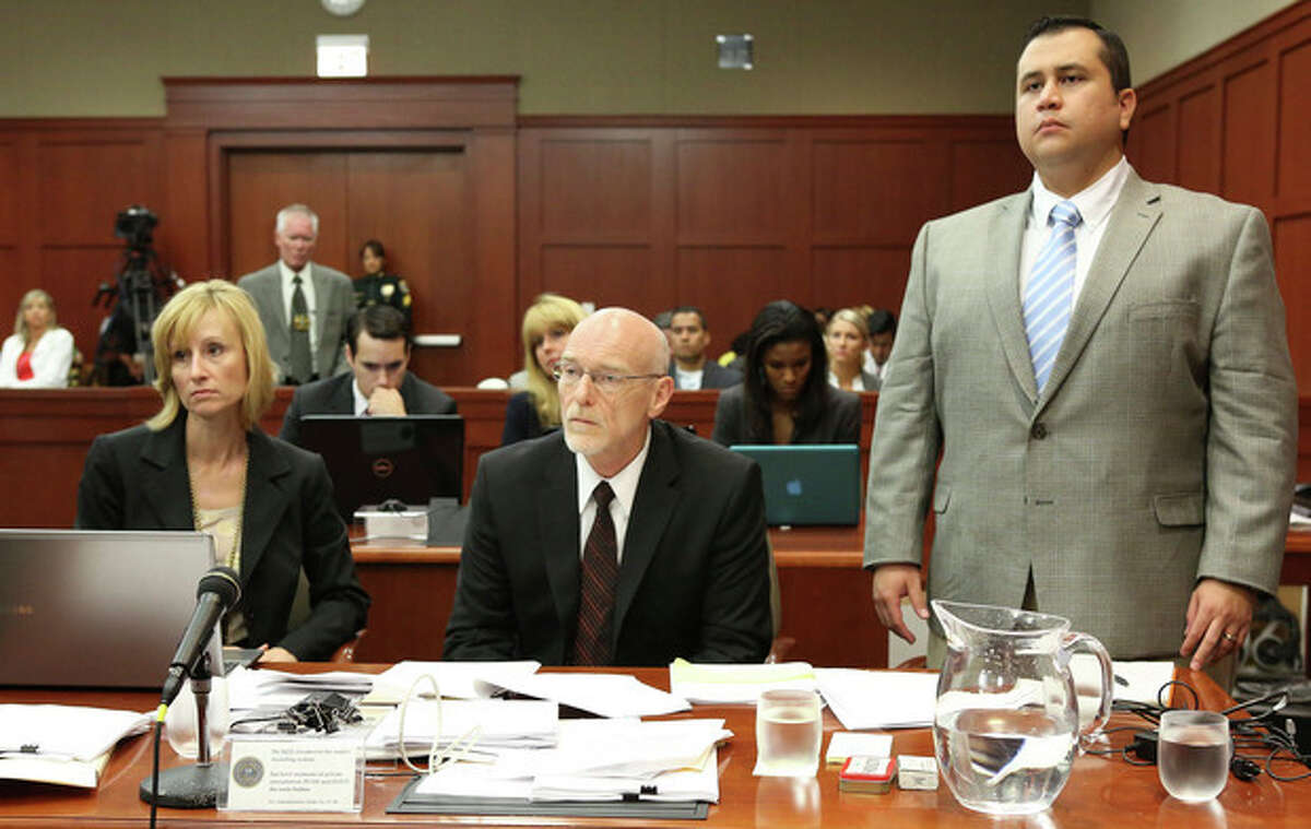 George Zimmerman stands for instructions from Judge Debra Nelson with attorney Lorna Truett, left, and Don West, center, during his trial in Seminole circuit court in Sanford, Fla. Thursday, July 11, 2013. Zimmerman has been charged with second-degree murder for the 2012 shooting death of Trayvon Martin. (AP Photo/Orlando Sentinel, Gary W. Green, Pool)