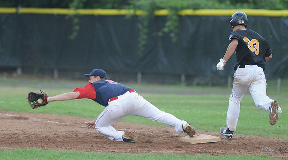 Hour photo/John Nash Norwalk's Eddie O'Hara stretches for a throw while holding the bag on a ground out to nail a Trumbull's Joe Nemcheck during the top of the sixth inning of Thursday's Babe Ruth District 2 championship game in Fairfield. Norwalk lost, 4-3.