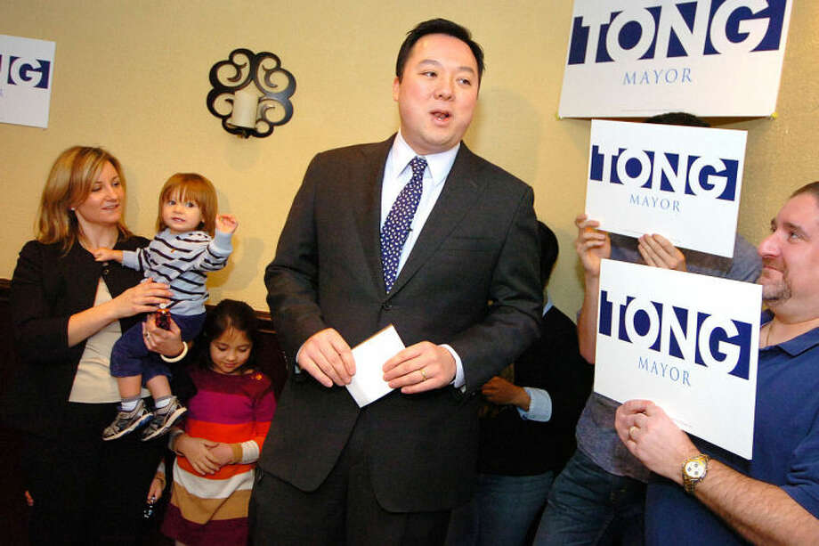 State Rep. William Tong surrounded by family and supportersannounces his run for Stamford Mayor at Sorrento Restaurant in Stamford Monday.