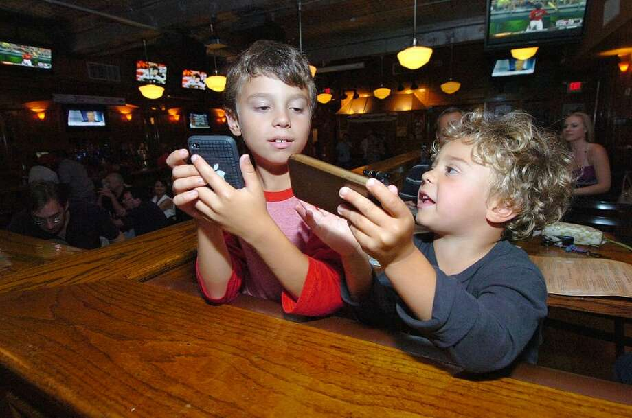 Hour Photo/ Alex von Kleydorff. young fans at Black Bear Saloon for Breaking The Band