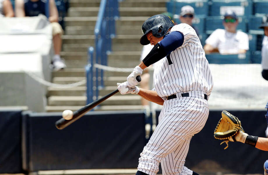 New York Yankees' Alex Rodriquez hits a single during the sixth inning for the Tampa Yankees against the Dunedin Blue Jays in a minor league baseball rehab game in Tampa, Fla., Wednesday, July 10, 2013. (AP Photo/Scott Iskowitz) / FRE170674 AP