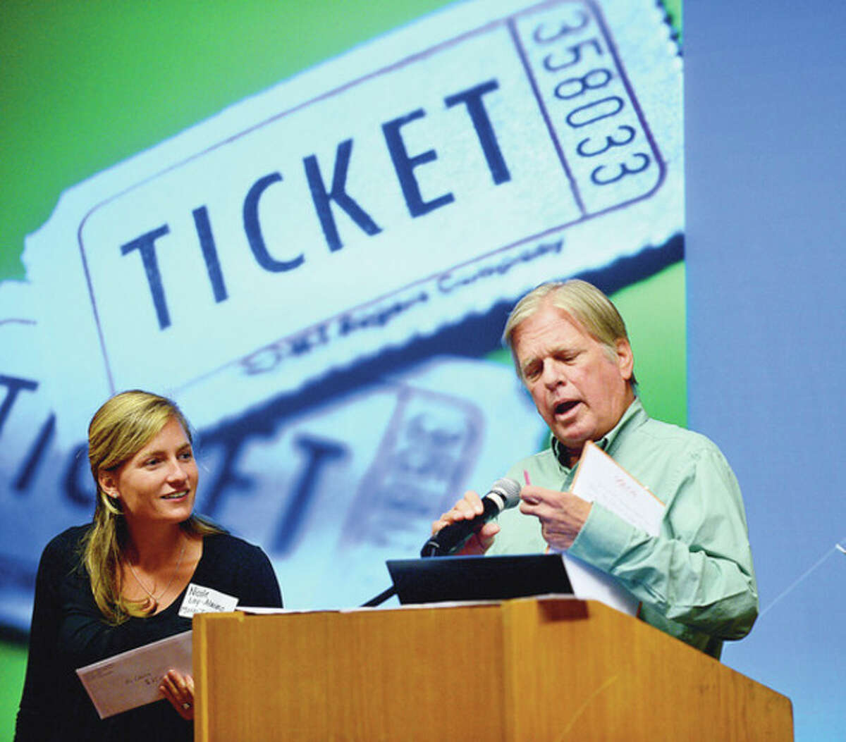 Briggs High School faculty Nicole Lay-Alaimo and Michael May draw raffle tickets at the culmination lunch for the faculty's retreat at Dolce Friday. Hour photo / Erik Trautmann