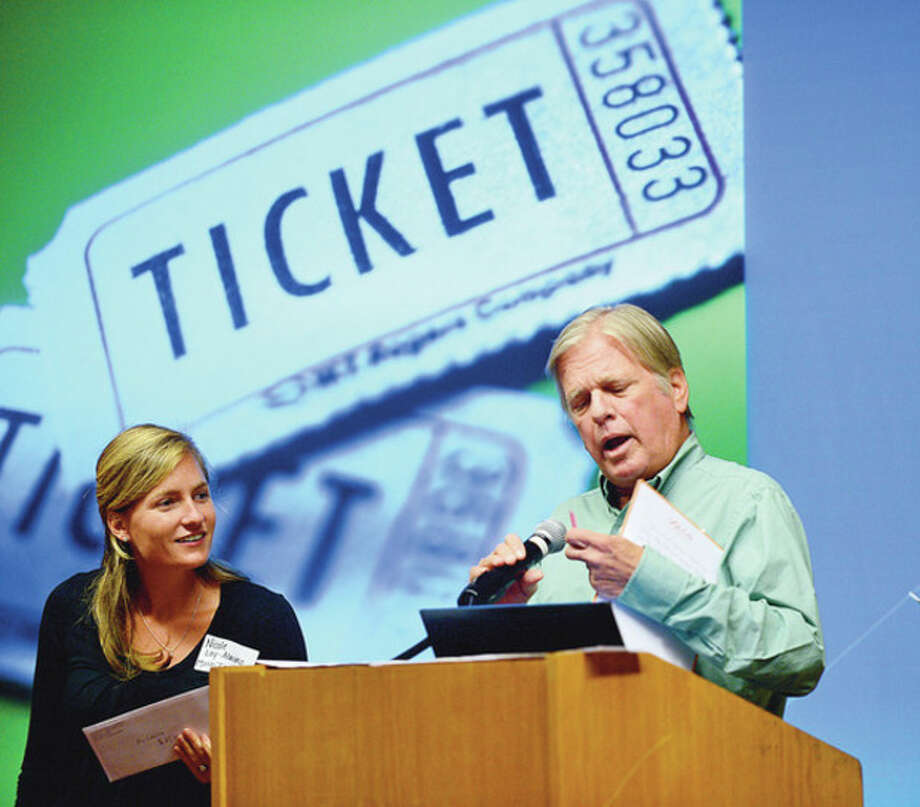 Briggs High School faculty Nicole Lay-Alaimo and Michael May draw raffle tickets at the culmination lunch for the faculty's retreat at Dolce Friday.Hour photo / Erik Trautmann / (C)2012, The Hour Newspapers, all rights reserved