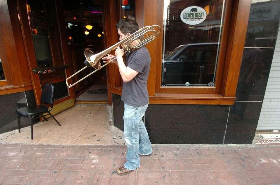Hour Photo/ Alex von Kleydorff. Brian Borelli warms up on the sidewalk for Breaking The Band