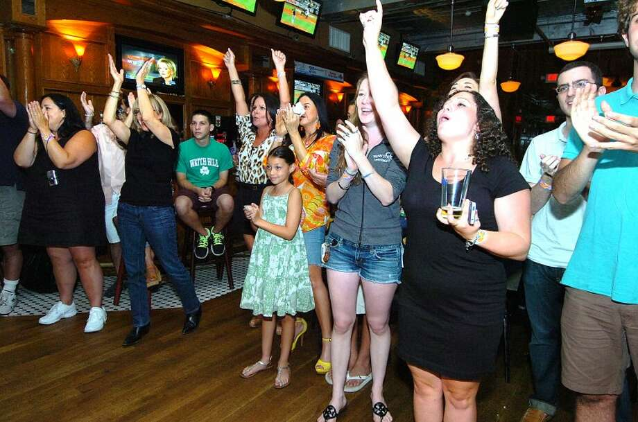 Hour Photo/ Alex von Kleydorff. Fans cheer for Marmalade Sky at Black Bear Saloon for Breaking The Band