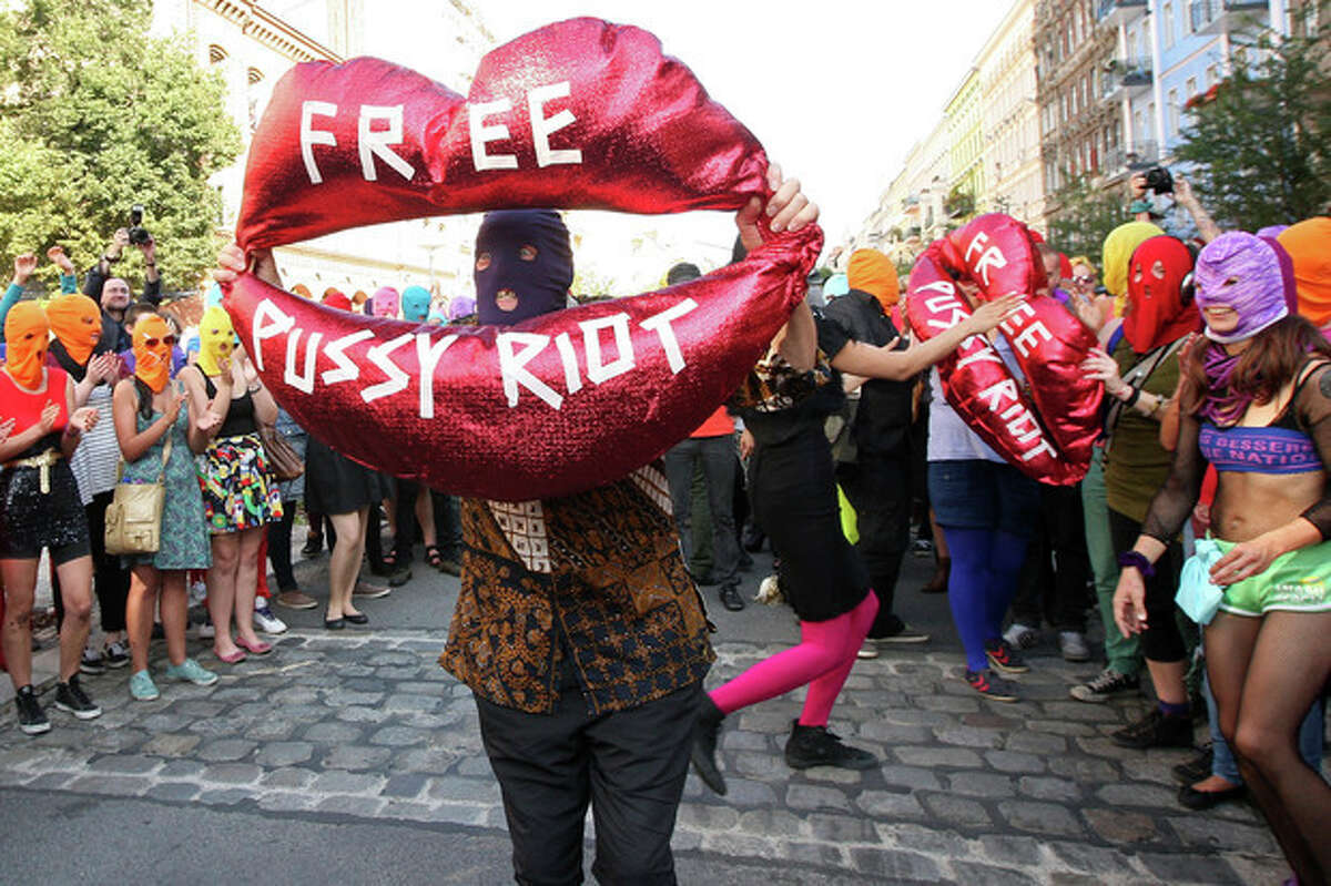 """Background actors show a balloon shaped as a mouth reading """"Free Pussy Riot"""" during the recording of a music video of Canadian musician and performance artist Peaches in support of members of the feminist punk group Pussy Riot in Berlin, Germany, Wednesday, Aug. 8, 2012. Prosecutors in Russia on Tuesday called for three-year prison sentences for feminist punk rockers who gave an impromptu performance in Moscow's main cathedral to call for an end to Vladimir Putin's rule, in a case that has caused international outrage and split Russian society. (AP Photo/dapd/Adam Berry)"""