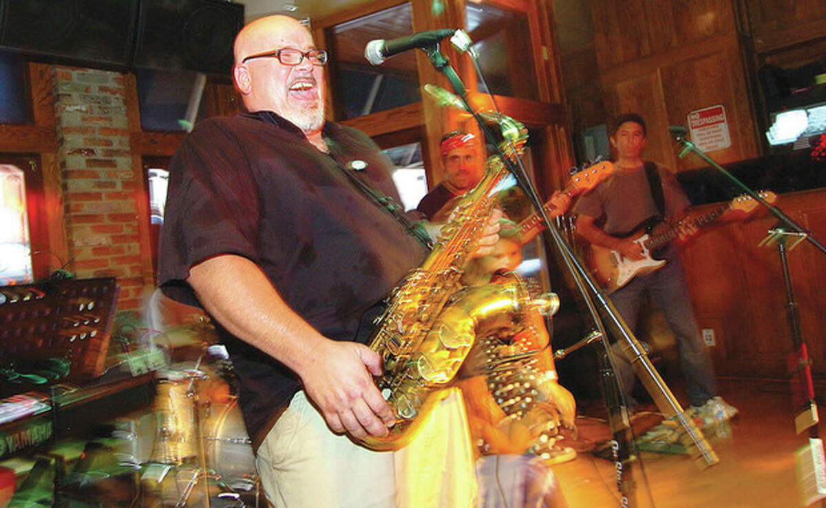 Hour Photo/ Alex von Kleydorff. Steve DeFalla on Saxaphone belts out lyrics with the band Juicy Grapes at Black Bear Saloon during the Hour's Newspapers Breaking The Band Battle in SONO Friday night