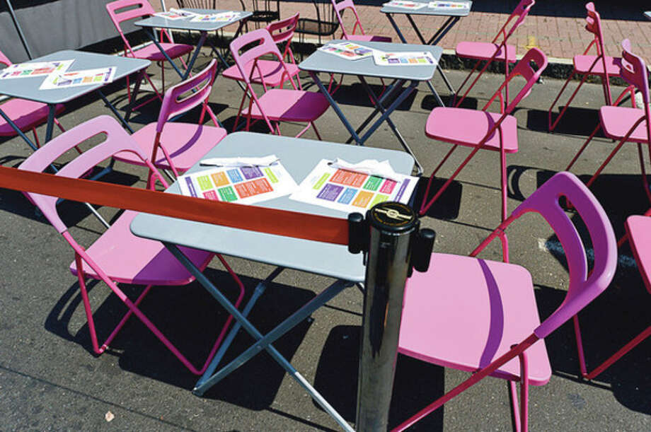 Colorful seating outside Chocopologie during The 37th Annual SoNo Arts celebration Saturday.Hour photo / Erik Trautmann / AP