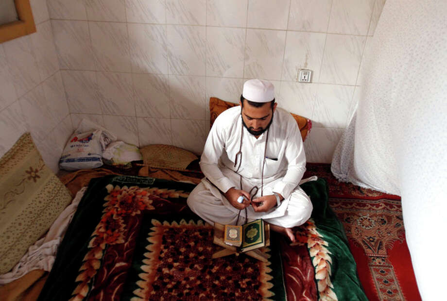 An Afghan Muslim devotee lives and prays in isolation in a mosque during Itikaf, the last ten days of the Islamic fasting month of Ramadan, in the city of Jalalabad east of Kabul, Afghanistan, Tuesday, Aug. 14, 2012. The last ten days of Ramadan, known as Itikaf, are very important according to many Muslims due to the belief that Prophet Muhammad used to exert himself even more in worship, hoping to draw himself closer to God. Itikaf involves total dedication to worship, reading Quran, and supplication. (AP Photo/Rahmat Gul) / AP