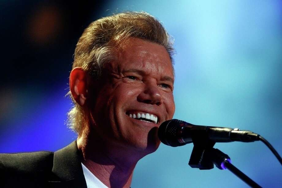 FILE - In this June 7, 2013 file photo, Randy Travis performs on day 2 of the 2013 CMA Music festival at the LP Field in Nashville, Tenn. Publicist Kirt Webster on Wednesday night, July 10, 2013 said that the 54-year-old Travis is in surgery after suffering a stroke while he was being treated for congestive heart failure because of a viral illness. (Photo by Wade Payne/Invision/AP, File) / Invision