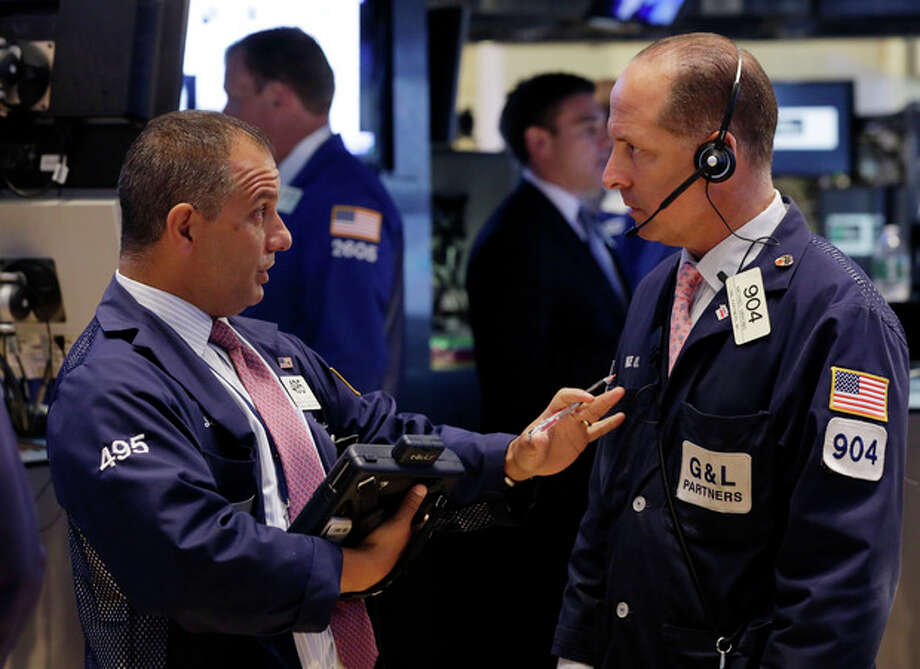 In this Monday, July 8, 2013 photo, traders Joel Lucchese, left, and Michael Urkonis confer on the floor of the New York Stock Exchange. Asian stock markets rebounded and European shares continued a global rally Tuesday July 9, 2013 following positive U.S. economic news as nervousness about an imminent scaling back of the Federal Reserve's monetary stimulus eased. (AP Photo/Richard Drew) / AP