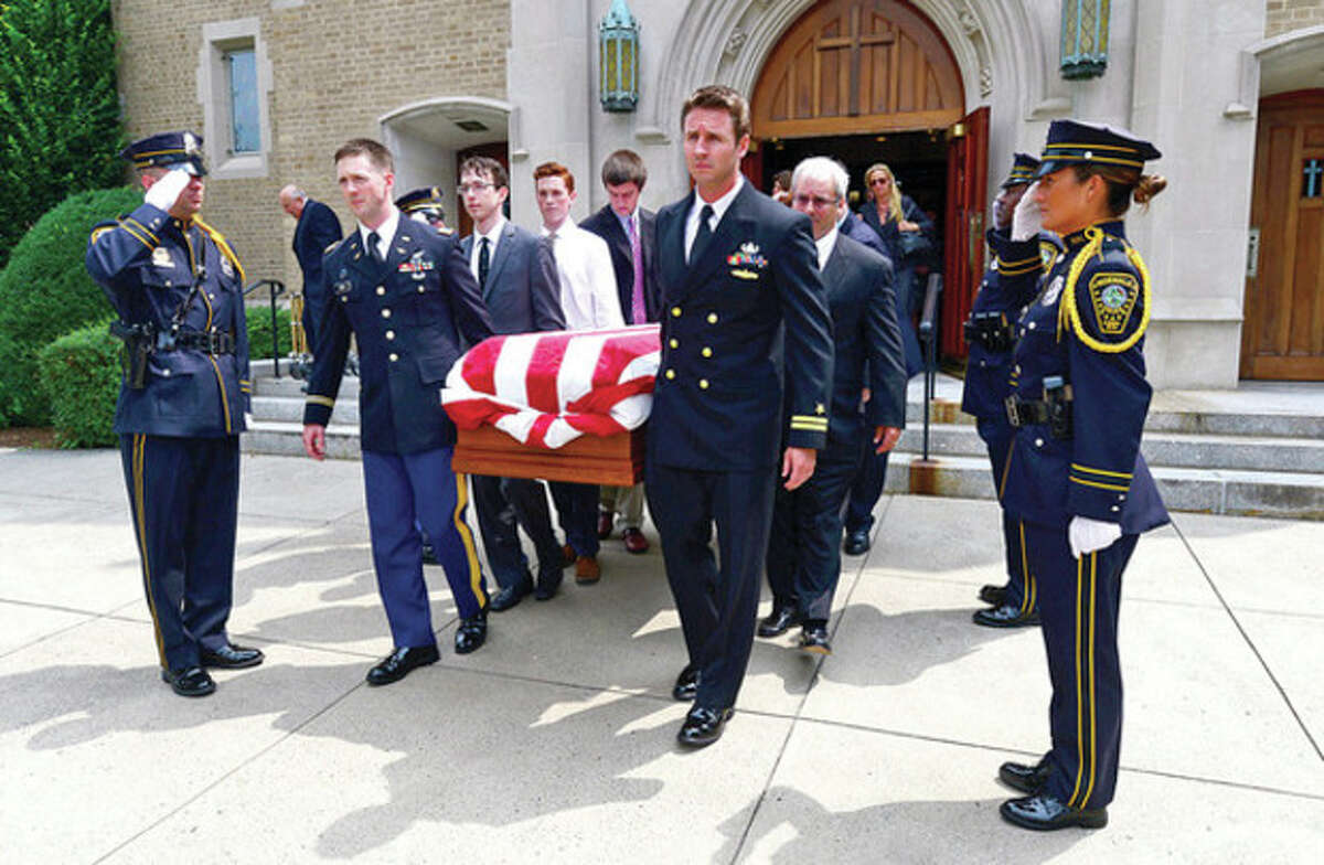 Hour photo / Erik Trautmann Pallbearers bring the casket of former mayor Don Irwin through the Norwalk Police Honor Guard following the service Wednesday at St. Thomas the Apostle Church.