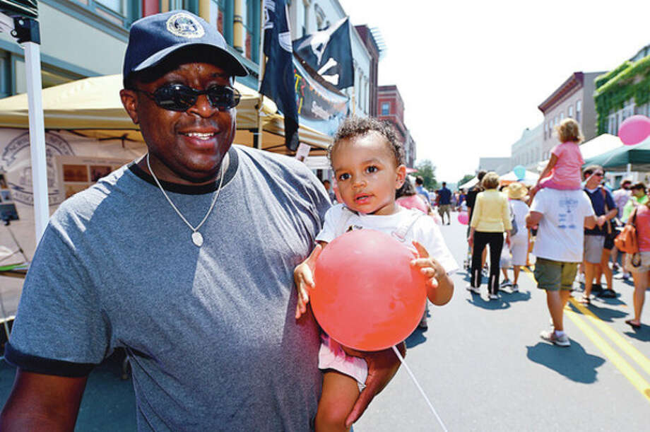 Andre Moore and his son, Gavin , enjoy The 37th Annual SoNo Arts celebration Saturday.Hour photo / Erik Trautmann / (C)2012, The Hour Newspapers, all rights reserved