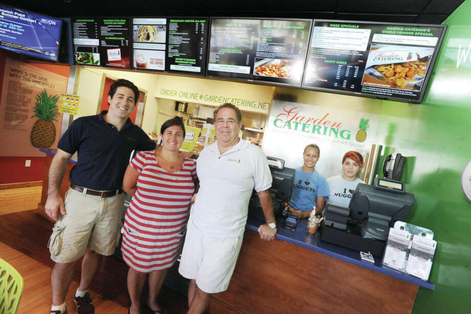 Hour photo/Matthew VinciThe new Garden Catering on Westport Avenue in Norwalk. Frank Carpenteri and Frank Carpenteri Jr. with manager Monika Rodriguez and employees, Judith Garcia and Karla Vega. / (C)2011 {your name}, all rights reserved