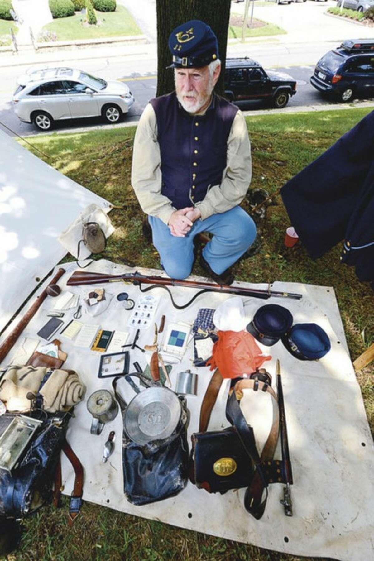 Civil War reeactor Martin Scmidt display Civil War era belongings during the Norwalk Historical Society's Civil War BBQ at Mill Hill Historic Park Saturday. Hour photo / Erik Trautmann