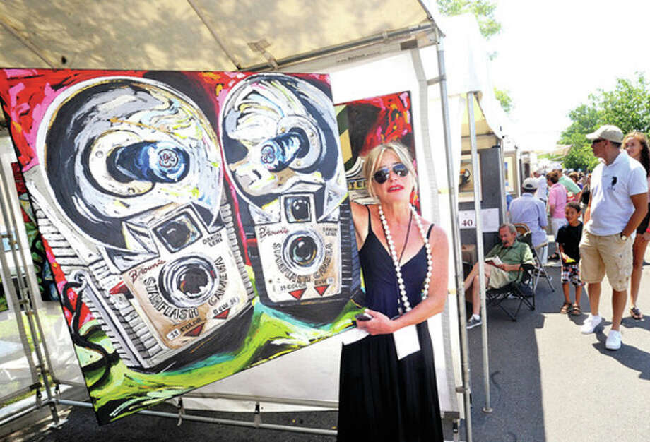 Hour photo/Matthew VinciArtist Julia Gilmore with her painting called Brownie Cameras was one of many showing work at the Westport Downtown Arts Festival last year.