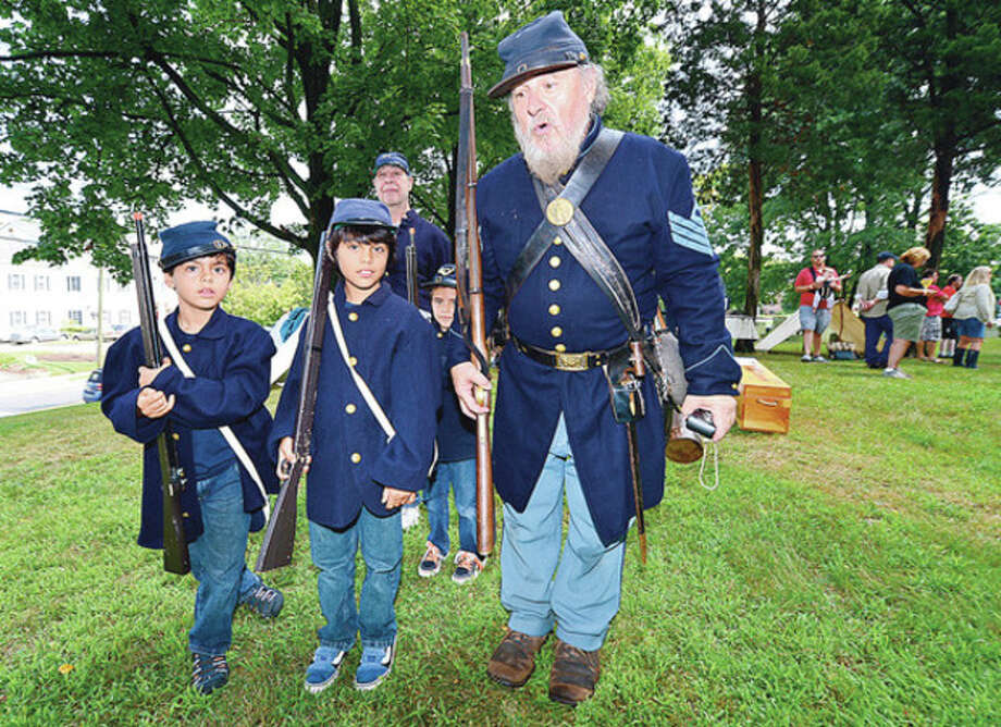 Jacob and Owen McDonald get trained in parade step by reenactor Ralph Langham during the Norwalk Historical Society's Civil War BBQ at Mill Hill Historic Park Saturday.Hour photo / Erik Trautmann / (C)2012, The Hour Newspapers, all rights reserved