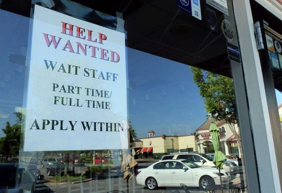 In this , Friday, June 21, 2013, photo, a Help Wanted sign is displayed in the window of a restaurant at a shopping center in Charlotte, N.C. The Labor Department reports on the number of Americans who applied for unemployment benefits last week on July 11, 2013. (AP Photo/Chuck Burton) / AP