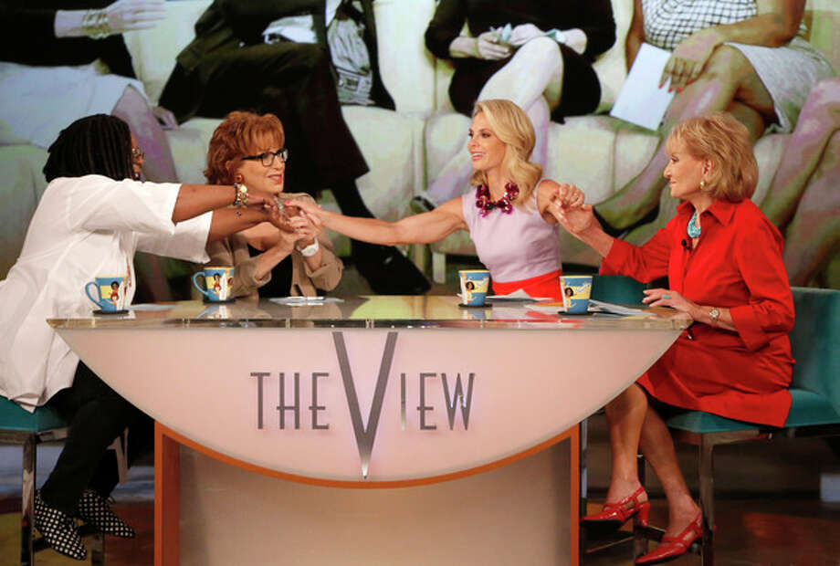 """This image released by ABC shows, from left, Whoopi Goldberg, Joy Behar, Elisabeth Hasselbeck and Barbara Walters, co-hosts on """"The View,"""" during a broadcast on Wednesday, July 10, 2013, in New York. Wednesday was Hasselbeck's last day on the daytime talk show. Her exit came less than 24 hours after it was announced that Hasselbeck will join Fox News Channel and the """"Fox & Friends"""" morning show in September. (AP Photo/ABC, Heidi Gutman) / American Broadcasting Companies, Inc."""