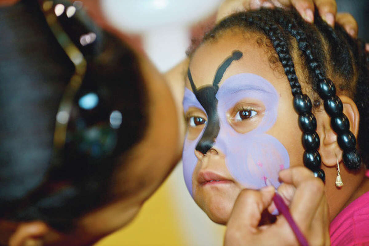 Tamariah Peterson, 4, gets her face painted during Roodner Court Family Day Saturday at Nathaniel Ely School. Hour photo / Erik Trautmann