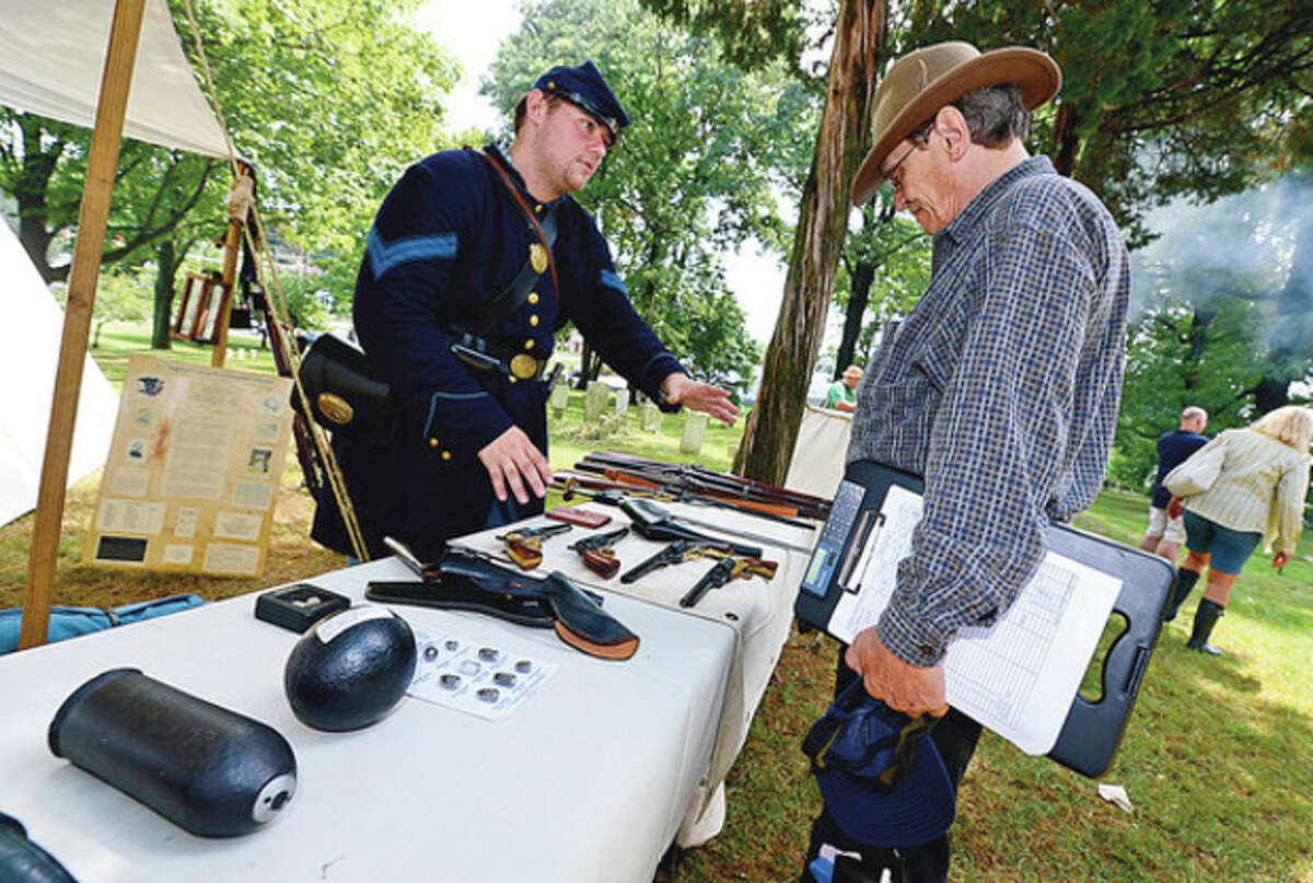 A variety of Civil War weapons were on display during the Norwalk Historical Society's Civil War BBQ at Mill Hill Historic Park Saturday. Hour photo / Erik Trautmann