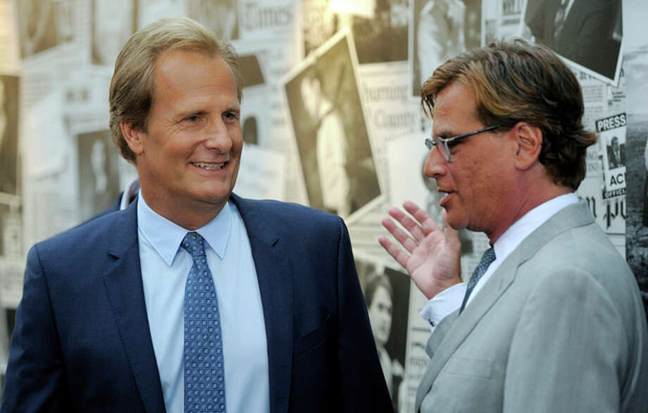 "Aaron Sorkin, right, creator/executive producer of ""The Newsroom,"" greets cast member Jeff Daniels at the season 2 premiere of the HBO series at the Paramount Theater on Wednesday, July 10, 2013 in Los Angeles. (Photo by Chris Pizzello/Invision/AP) / Invision"