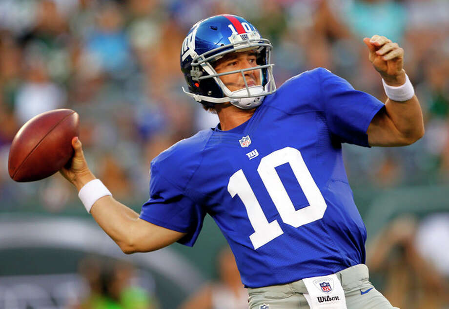 New York Giants quarterback Eli Manning throws a pass against the New York Jets during the first half of a preseason NFL football game on Saturday, Aug. 18, 2012, in East Rutherford, N.J. (AP Photo/Rich Schultz) / FRE27227 AP