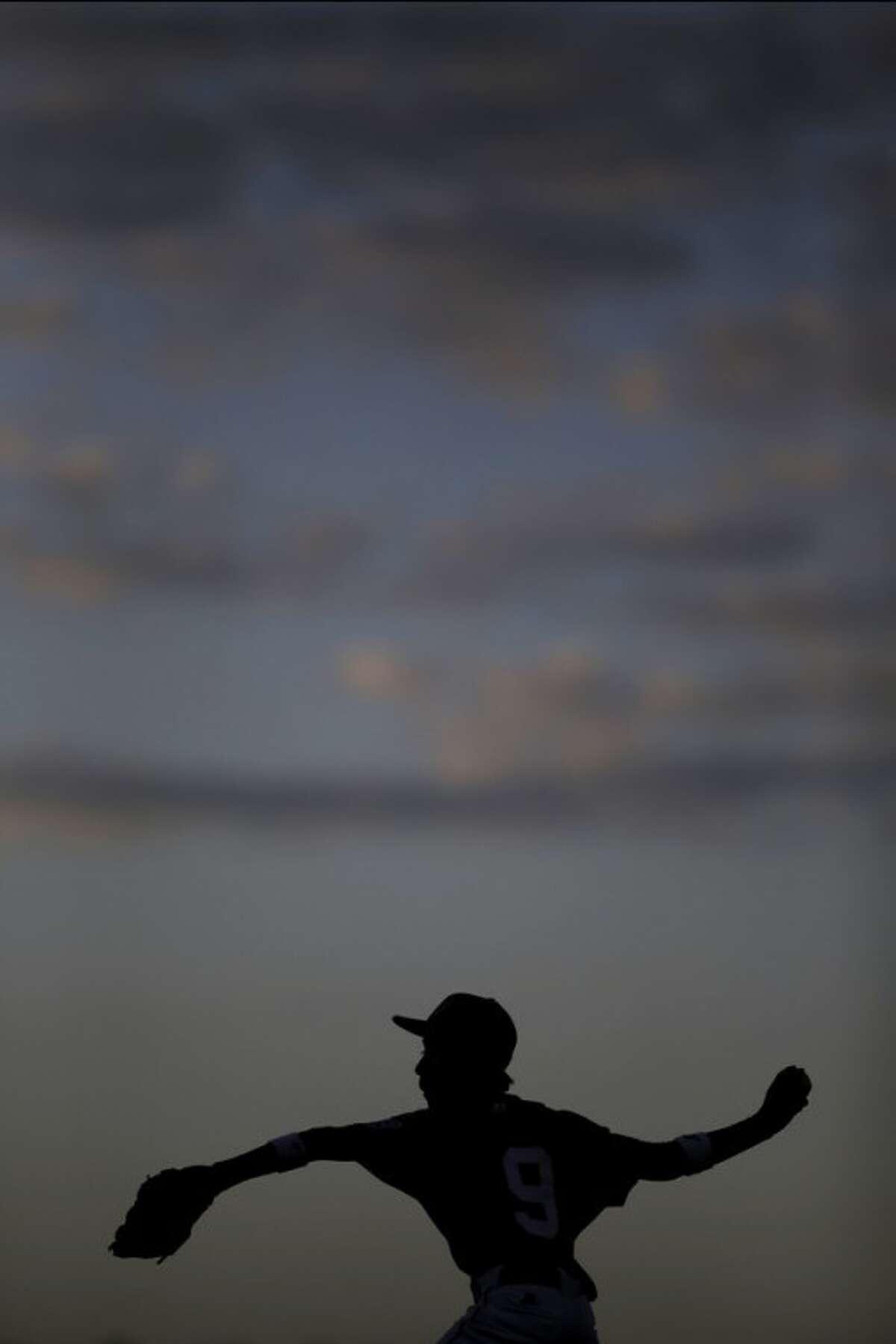 Nuevo Laredo, Mexico's Joel Turrubiates pitches in the fourth inning of a pool play baseball game against Lugazi, Uganda at the Little League World Series, Saturday, Aug. 18, 2012, in South Williamsport, Pa. Mexico won 12-0. (AP Photo/Matt Slocum)