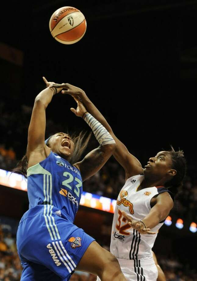 Connecticut Sun's Kalana Greene, right, fouls New York Liberty's Cappie Pondexter during the first half of a WNBA basketball game in Uncasville, Conn., Saturday, Aug. 18, 2012. (AP Photo/Jessica Hill)