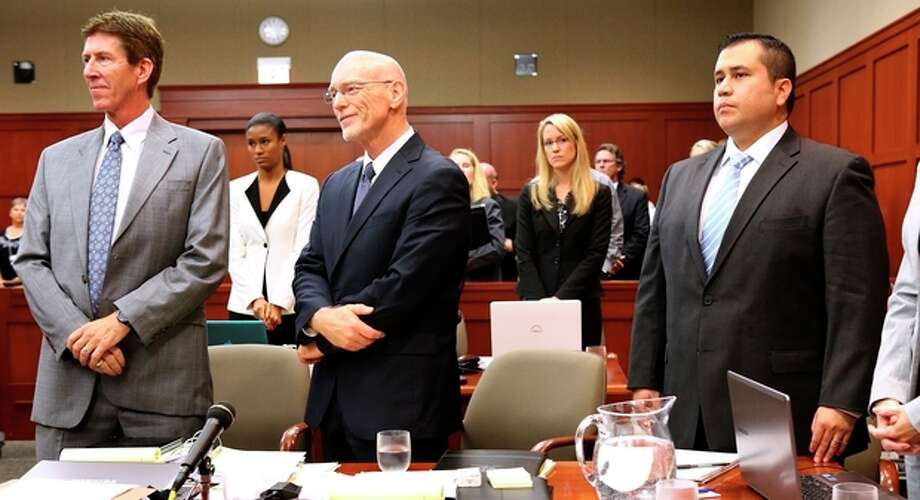 George Zimmerman, right, stands with his attorneys, Mark O'Mara, left, and Don West, center, as the jury enters the courtroom during the 16th day of his trial in Seminole circuit court, in Sanford, Fla., Monday, July 1, 2013. Zimmerman has been charged with second-degree murder for the 2012 shooting death of Trayvon Martin.(AP Photo/Orlando Sentinel, Joe Burbank, Pool) / Pool Orlando Sentinel