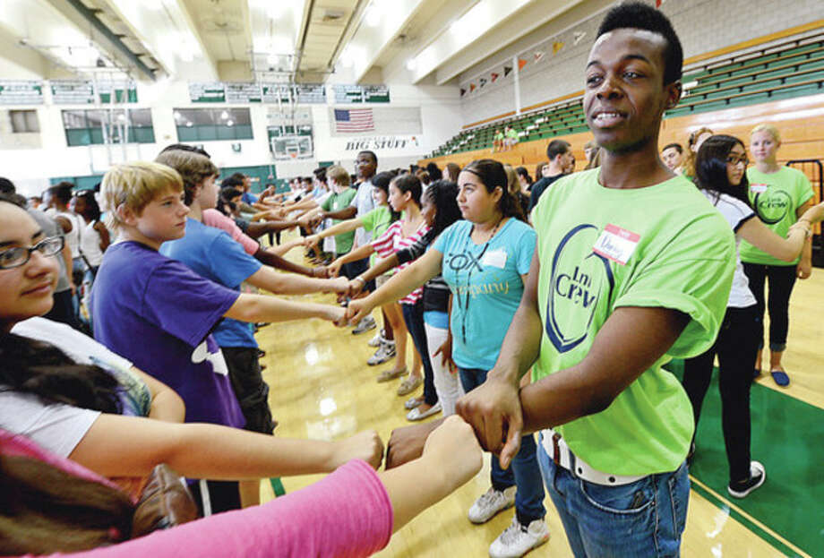 85 members of this year's Norwalk High School senior class including Darius Colson participated with an orientation program with over 140 incoming freshman as part of the new Link Crew program at the school. The program has seniors mentor and guide freshmen to be successful during the transition to high school.Hour photo / Erik Trautmann / (C)2012, The Hour Newspapers, all rights reserved