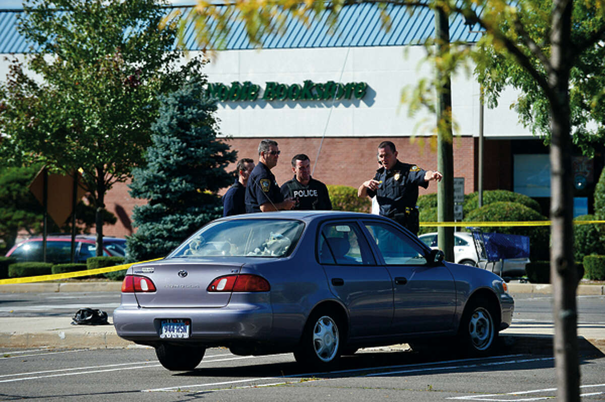 Norwalk police investigate a shooting at Super Stop and Shop where a woman was shot in an apparent robbery in October 2012. Hour photo / Erik Trautmann