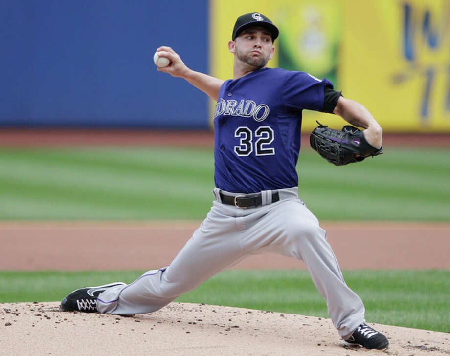 Colorado Rockies' Tyler Chatwood delivers a pitch during the first inning of a baseball game against the New York Mets, Thursday, Aug. 23, 2012, in New York. (AP Photo/Frank Franklin II) / AP
