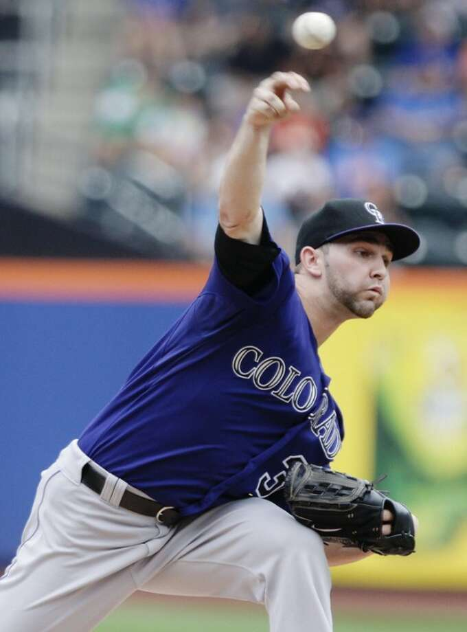 Colorado Rockies' Tyler Chatwood delivers a pitch during the first inning of a baseball game against the New York Mets, Thursday, Aug. 23, 2012, in New York. (AP Photo/Frank Franklin II)