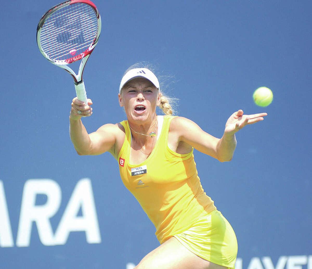 Hour photo/John Nash Denmark's Caroline Wozniacki hits a return during the second set of Thursday's 6-2, 6-1 quarterfinal win over Dominika Cibulkova at the New Haven Open at Yale.