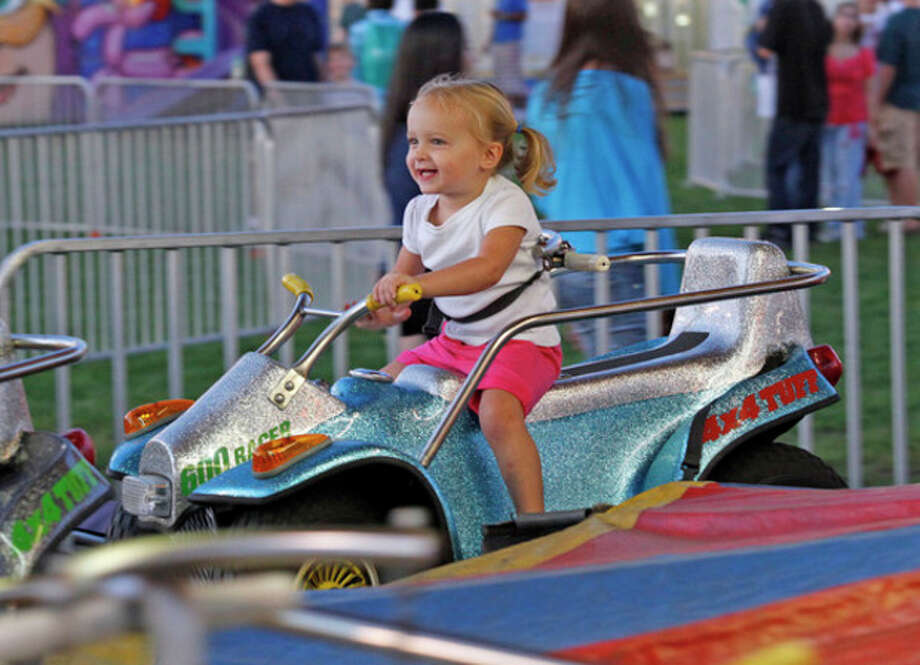Hour file photoLiza Fogelson, 2 1/2, enjoys a ride at the 2011 Oyster Festival