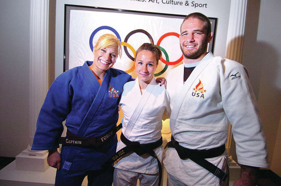Hour photo/Alex von KleydorffA trio of U.S. Olympians -- from left, gold medalist Kayla Harrison, bronze medalist Marti Malloy and Travis Stevens, who placed fifth -- were at the Bruce Museum in Greenwich Thursday to talk to youngsters and demonstrate their sports. / 2012 The Hour Newspapers