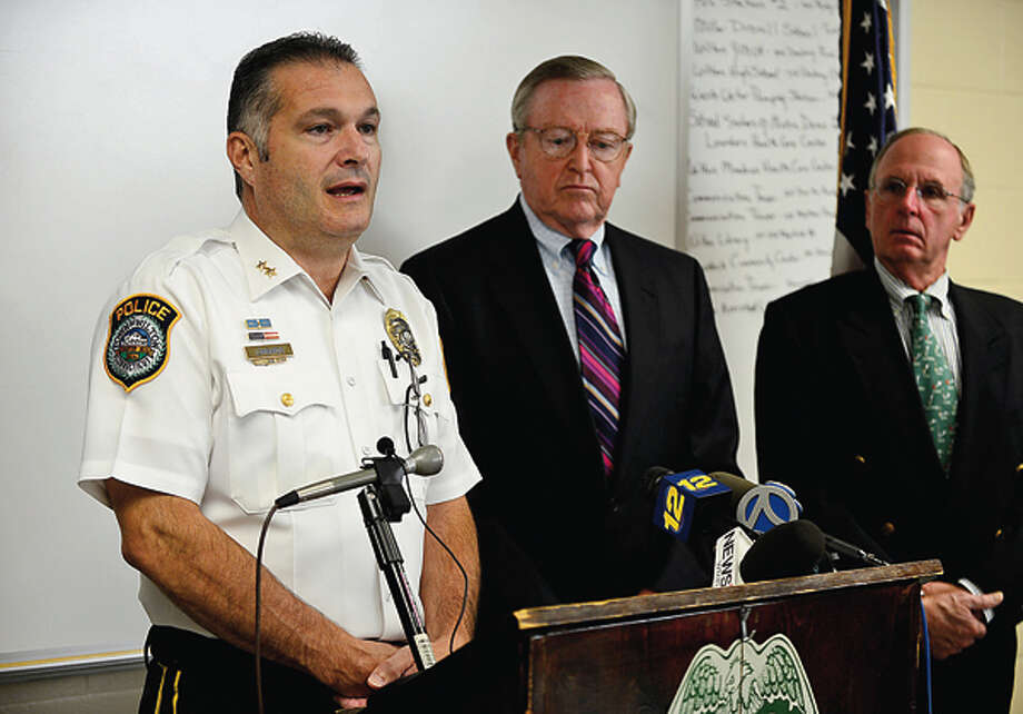 Wilton Police Chief Michael Lomabardo holds a press conference with first selectman Bill Brennan and police commisioners including Donald Sauvigne to announce an arrest in the Nick Parisot killing. Hour photo / Erik Trautmann