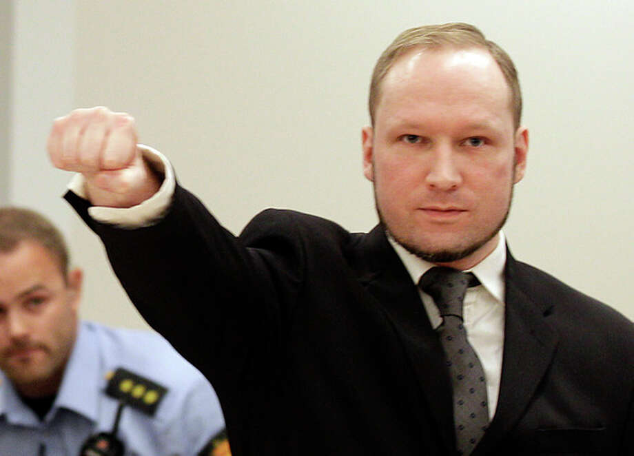 Mass murderer Anders Behring Breivik, makes a salute after he arrives at the court room in a courthouse in Oslo Friday Aug. 24, 2012 . Breivik has been declared sane and sentenced to prison for bomb and gun attacks that killed 77 people last year. (AP Photo/Frank Augstein) / AP