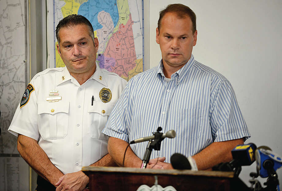 Wilton Police Chief Michael Lomabardo holds a press conference with Lt Don Wakemen and others to announce an arrest in the Nick Parisot killing. Hour photo / Erik Trautmann
