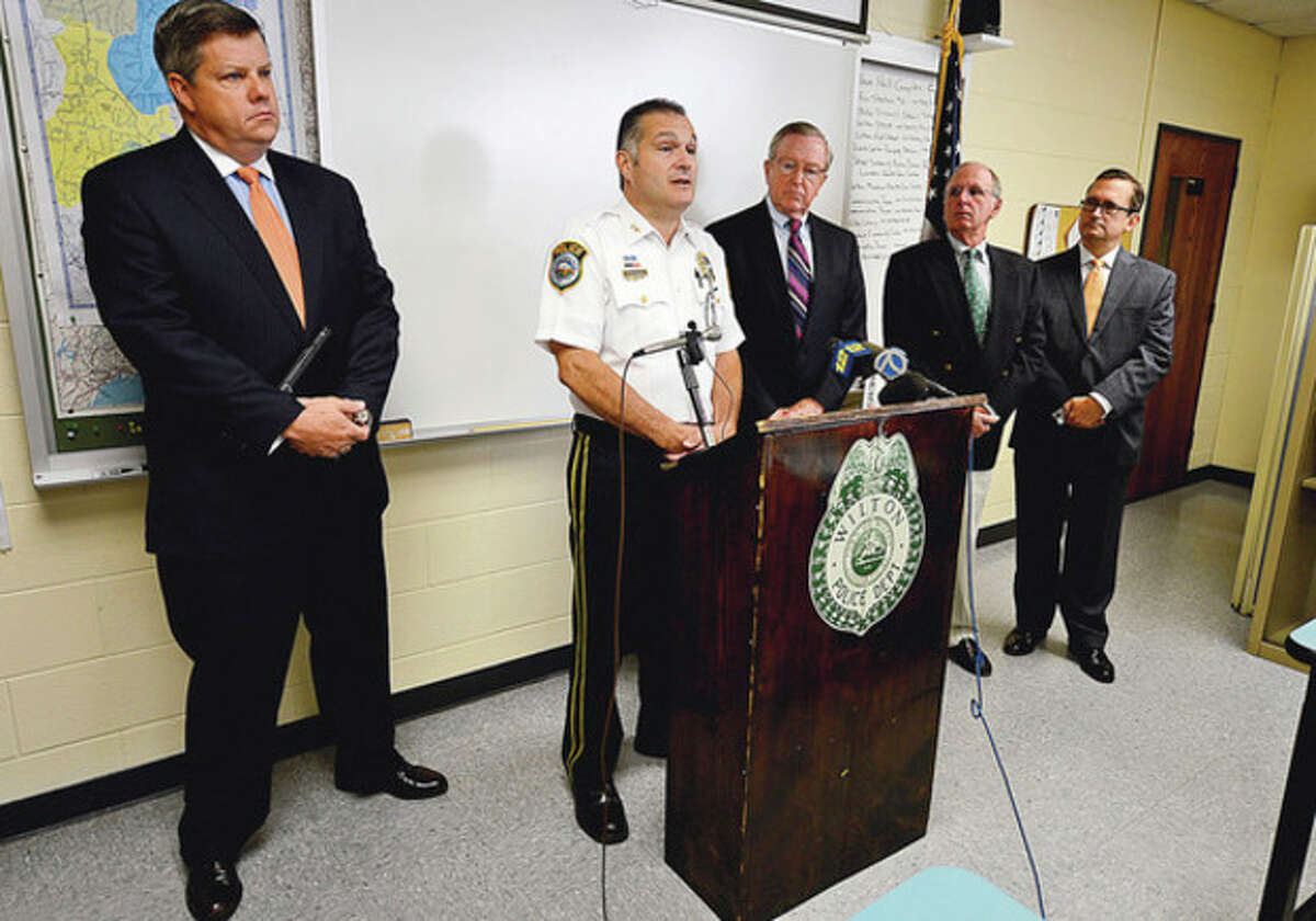 Wilton Police Chief Michael Lomabardo holds a press conference with first selectman Bill Brennan and police commisioners Christopher Weldon, Donald Sauvigne and David Waters to announce an arrest in the Nick Parisot killing. Hour photo / Erik Trautmann
