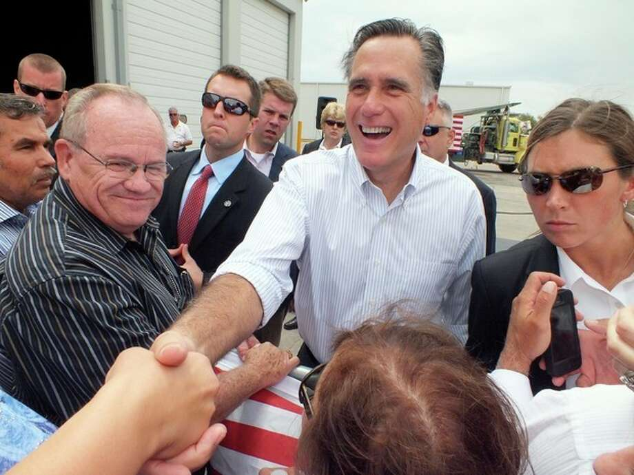 Republican presidential candidate, former Massachusetts Gov. Mitt Romney shakes hands during a campaign event at Watson Truck and Supply, Thursday, Aug. 23, 2012, in Hobbs, N.M. (AP Photo/Hobbs News-Sun, Todd Bailey) / Hobbs News-Sun
