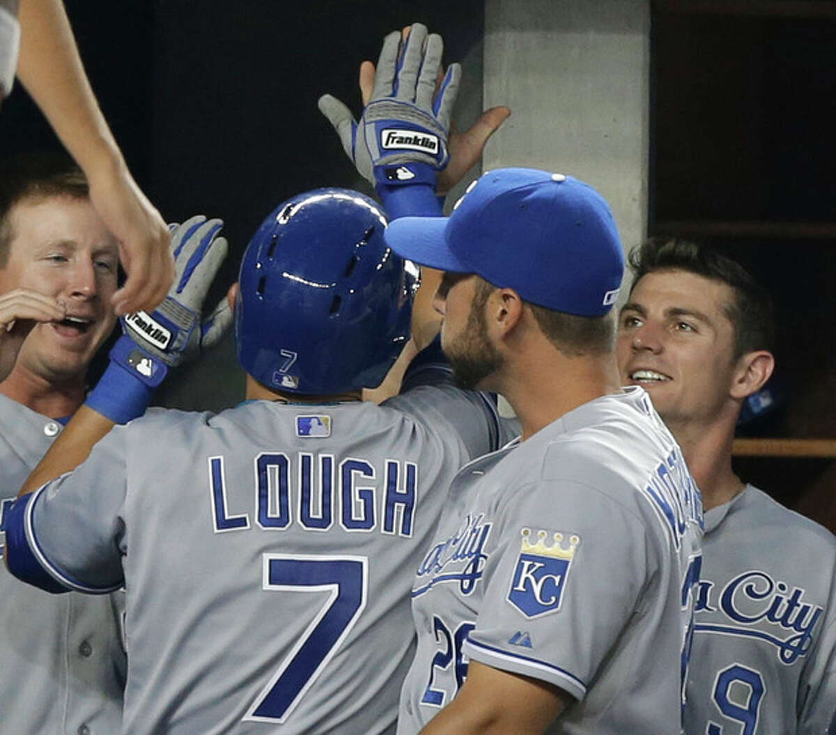 Kansas City Royals congratulate David Lough after his sixth-inning solo home run off New York Yankees starting pitcher CC Sabathia in a baseball game Tuesday, July 9, 2013, in New York. (AP Photo/Kathy Willens)