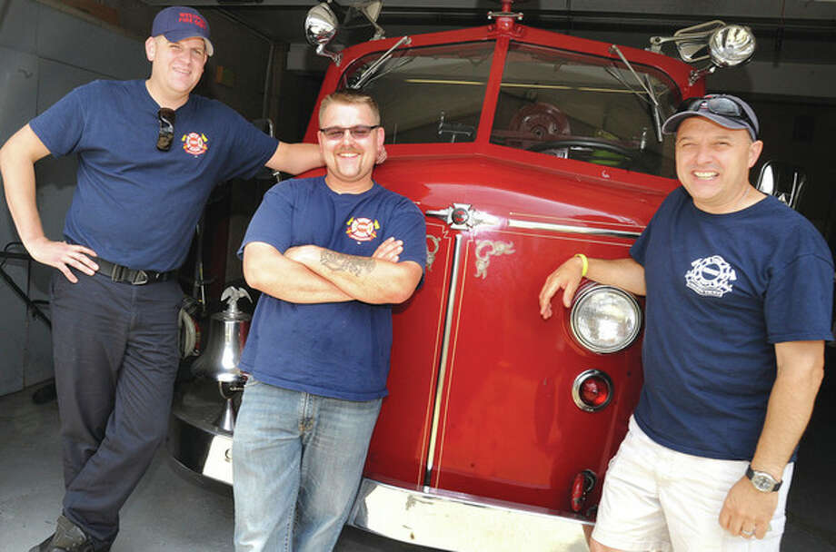 Hour photo / Matthew VinciFirefighters from the Saugatuck Fire Station will particiapte in a cookoff at the Fairway in Stamford on July 13th. From left, James Workman, Joe Arnson and Brett Kirby.