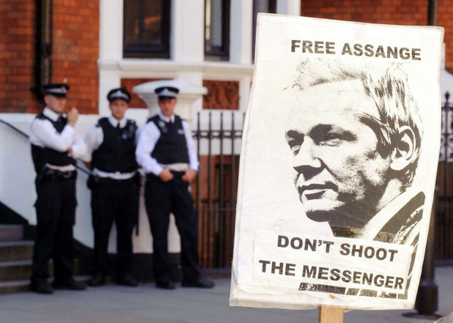 A pro-Julian Assange placard is seen outside the Embassy of Ecuador, in central London, Saturday August 18, 2012, where Wikileaks founder Julian Assange is claiming asylum in an effort to avoid extradition to Sweden. Authorities in Sweden want to question Assange over allegations made by two women who accuse him of sexual misconduct during a visit to the country in mid-2010, but Assange asserts that the US will try to extradite him from Sweden to answer allegations relating to the WikiLeaks publication of US secrets. (AP Photo / Dominic Lipinski/PA) UNITED KINGDOM OUT - NO SALES - NO ARCHIVES / PA