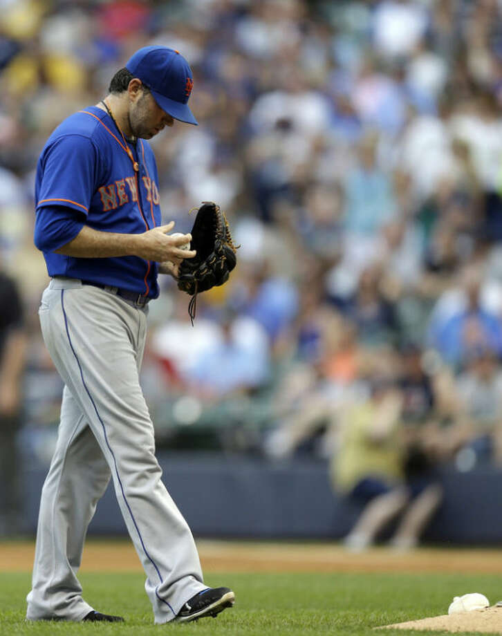 New York Mets starting pitcher Shaun Marcum walks back to the mound during the third inning of a baseball game against the Milwaukee Brewers, Saturday, July 6, 2013, in Milwaukee. (AP Photo/Jeffrey Phelps)