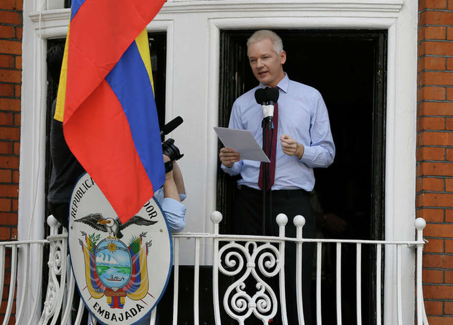 "Julian Assange, founder of WikiLeaks makes a statement from a balcony of the Equador Embassy in London, Sunday, Aug. 19, 2012. Assange called on United States President Barack Obama to end a ""witch hunt"" against the secret-spilling WikiLeaks organization.(AP Photo/Kirsty Wigglesworth) / AP"