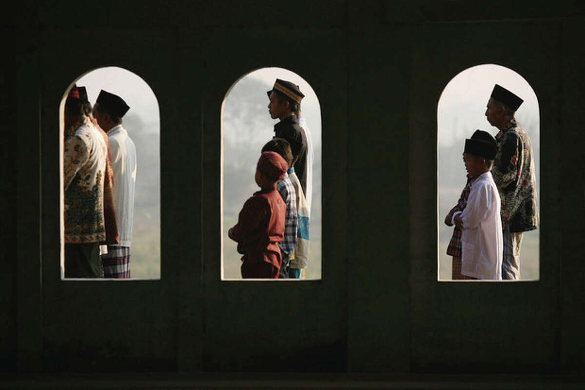 Indonesian Muslims perform Eid al-Fitr prayers that mark the end of the holy fasting month of Ramadan at a mosque in Porong, East Java, Indonesia, Sunday, Aug. 19, 2012. (AP Photo/Trisnadi)